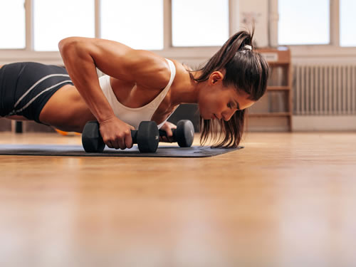 Woman pushing weights